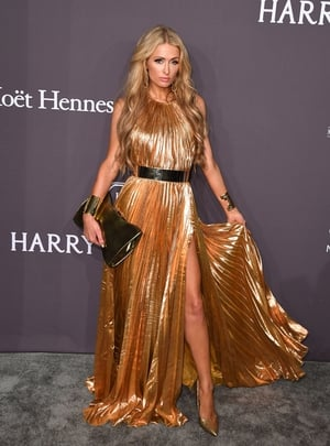 Heiress Paris Hilton looked stunning in a gold Maria Lucia Hohan gown.