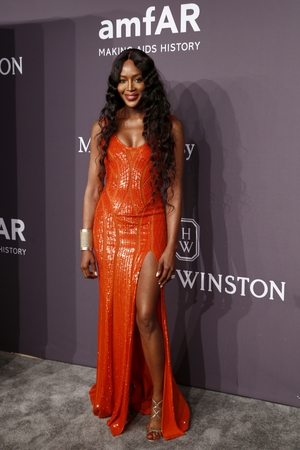 Supermodel Naomi Campbell glittered in Atelier Versace.