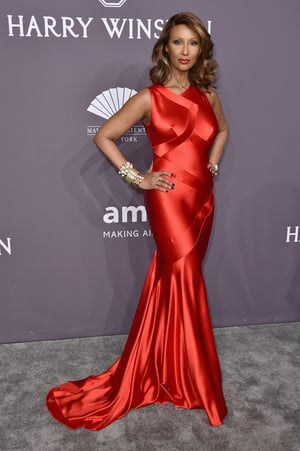 Model, actress, entrepreneur and all round icon Iman sizzled in a scarlet floor length dress. How is she 61?!