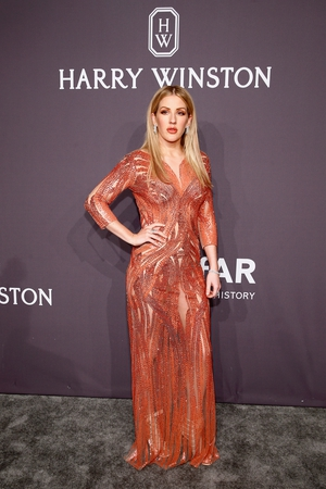 Singer Ellie Goulding shone in a Jenny Packham dress and Harry Winston diamonds.