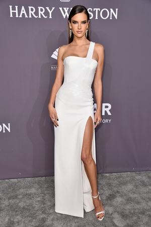 Model and actress Alessandra Ambrosio looked statuesque in a white Versace gown.