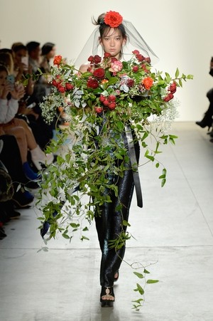 Thursday Day 1: A flower among flowers at the Adam Selman fashion show.