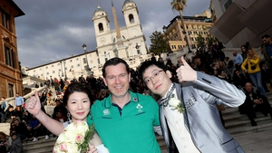 Ireland fan Dave Sheehan with a bride and groom at the Spanish Steps in Rome