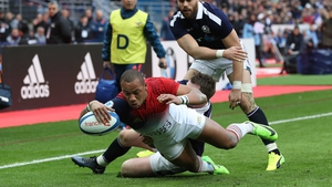 France's Gael Fickou scores a try