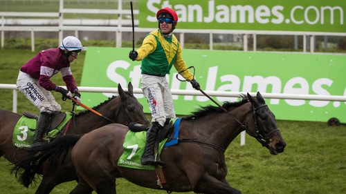 Jockey Robbie Power celebrates after his win aboard Sizing John at Cheltenham