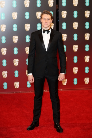Captain Fantastic star George MacKay looked very handsome in his tux and even had his trademark locks cut for the event!