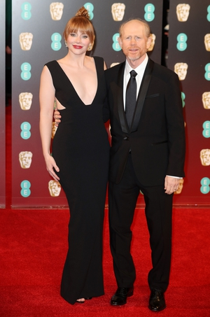 Bryce Dallas Howard took to the red carpet in a daring cut-out, plunging black dress to accompany her father Ron Howard whose documentary, The Beatles: Eight Days a Week, is nominated.