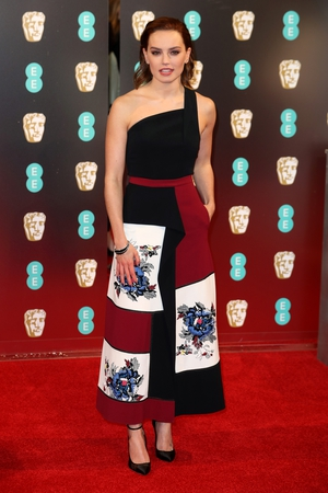 Mmm: We love the shape of Daisy Ridley's one shoulder pinafore midi dress but we're not sure about the unusual floral detail.