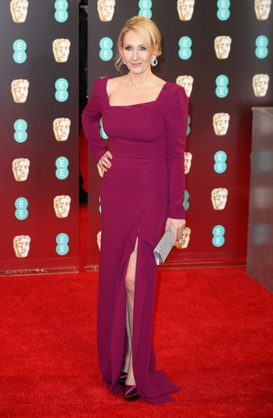 Nominated for Fantastic Beasts and Where to Find Them, J. K. Rowling wearing a beautiful rich colour and slightly less dramatic thigh-high split.