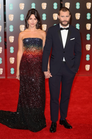 Another striking couple pose for the cameras - this time its our own Jamie Dornan and his wife Amelia Warner.