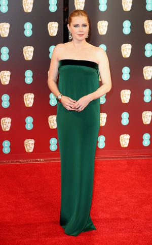 Mmm: Usually we would call this Tom Ford dress a miss but we have to give Amy Adams props for skipping the plunging neck line, tiered, thigh split trends. Plus, we love her in green.