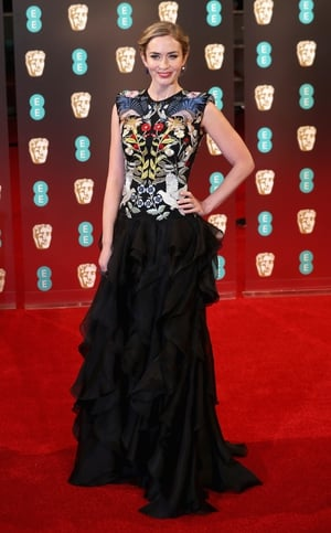 Best: Emily Blunt looks fabulous in this unusual graphic fitted bodice with ruffled skirt by Alexander McQueen.