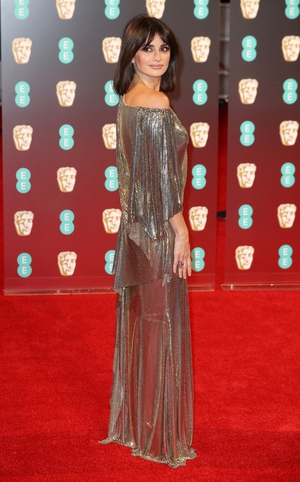 Mmm: Chopped hair and silver sequins suit Penelope Cruz but this dress looks a little messy for the red carpet.