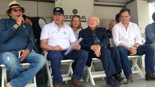 Michael D Higgins listens to an address by FARC commander Pastor Alape during his visit to a demobilisation camp