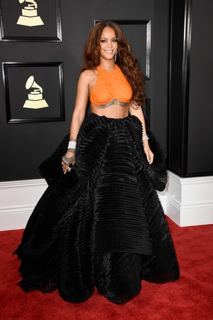 Mmmm: Rihanna looks radiant but that Armani Privé mini-crop top and skirt are a very unusual combo.