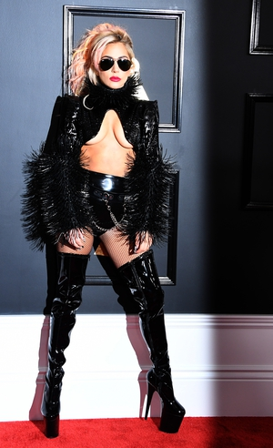 Best: Lady Gaga looked amazing and all-out-rock star in insane platform boots by Chrome Hearts. Plus a little leather, feathers and that barely there top. #rockinit