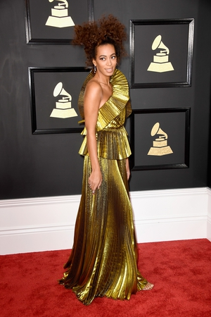 Singer Solange Knowles shimmered on the night in a Gucci dress and Maryam Nassir Zadeh shoes.