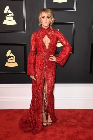 Miss: American singer/songwriter Carrie Underwood is lost in this fussy Elie Madi gown.