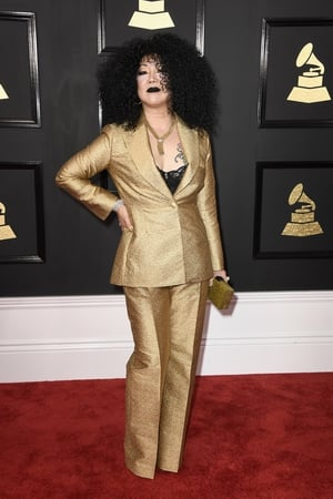 Worst: Margaret Cho are you in there? Big hair, black lips and power house gold suit. Looks like the comedian is having fun though.