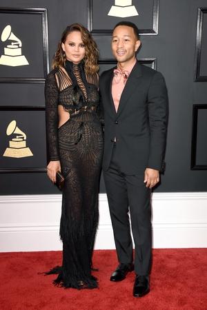 How do model Chrissy Teigen and musician John Legend always look so perfect? Those Coomi earrings defo help.