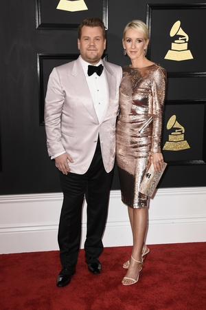Grammys host James Corden with his wife Julia Carey are perfectly co-ordinated in shimmery gold.