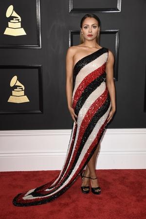 Mmmm: Again singer/actress Kat Graham's Jean Paul Gautier Haute Couture dress? Stunning. The woman herself looks a bit serious.