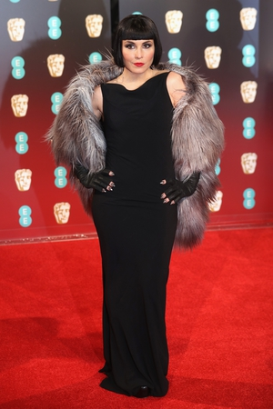 Actress Noomi Rapace went all out with her red carpet look with a twneties style bob and fur stole.