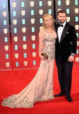 Sam Taylor-Johnson and Aaron Taylor-Johnson make a dashing couple. Sam looks etheral in an embellished Tom Ford.