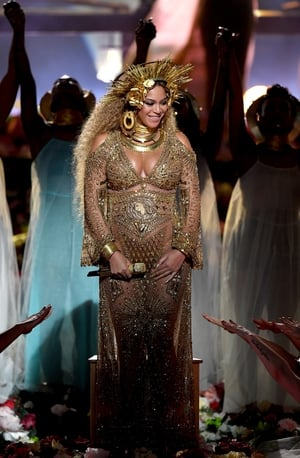 At this year's Grammys, Beyoncé proved that she ran the world in her Peter Dundas dress and crown.