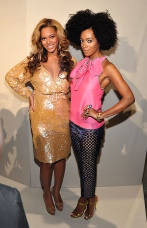 Beyoncé and her sister Solange Knowles, at New York Fashion Week in 2011. Queen B glows in a J. Crew gold dress.