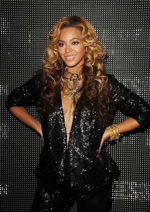 Queen B and her shy baby bump under a sequined blazer and pants a the launch of House Of Dereon By Beyonce And Tina Knowles.
