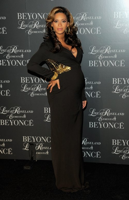 Beyonce hosts a screening of her 'Live At Roseland: The Elements Of 4' in 2011, super chic showing her bump in a black Roberto Cavalli gown.