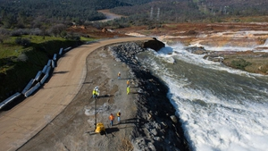 Crews assess the damage to the spillway