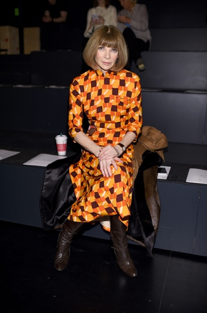 Sunday Day 4: Another snap of Anna Wintour attending the Prabal Gurung fashion show in a geometric orange tones dress.