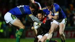 Kerry's David Moran, Mark Griffin and Tadhg Morley attempt to tackle Andy Moran