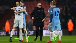 Pep Guardiola congratulates his players on the win over Bournemouth