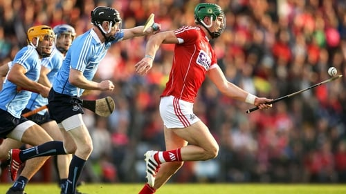 Aidan Walsh (R) evades Oisin O'Rorke of Dublin in last summer's All-Irerland SHC qualifier