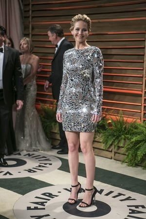 Ms Lawrence arrives to the 2014 Vanity Fair Oscar Party on March 2, 2014 wearing a fabulous Tom Ford mini-dress.