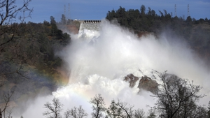 Operators at damaged California dam release water through main spillway