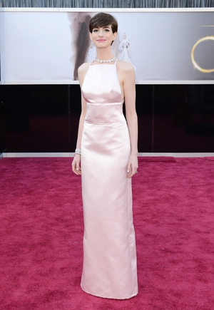 Anne is simply magnificent in this minimal pink column Prada dress in 2013. We think this is her best Oscars look to date. She won the Oscar on the night for Best Supporting Actress in 'Les Miserables'.