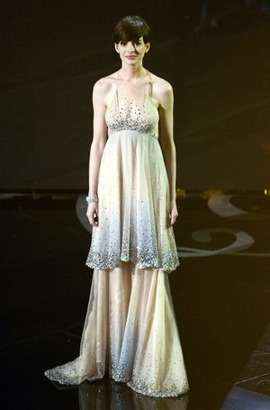 Anne performed onstage at the ceremony in 2013 with the 'Les Miserables' cast in a beautiful Giorgio Armani milky way-like dress, the same year she won the Oscar. Out of this world.