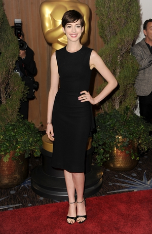 The actress attends the Nominees Luncheon in 2013 in a little black dress from The Row! Very sophisticated.