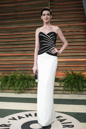 Anne wearing a beautiful black and white Viktor & Rolf bustier dress at the 2014 Vanity Fair Oscar Party.