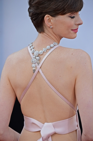 And check out the back! Anne looks like Audrey Hepburn with that pixie haircut and gorgeous embellishments.