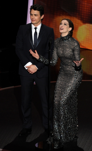 Actors James Franco and Anne Hathaway presenting the 83rd the ceremony in 2011. Anne is iconic in a shiny and dark Tom ford gown.