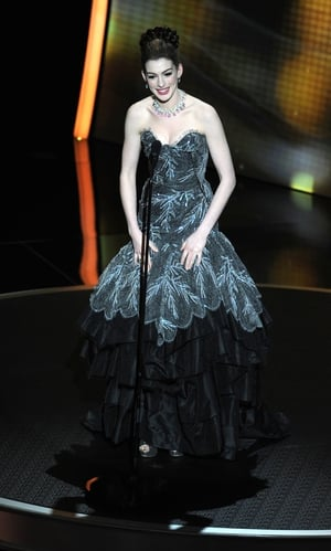 Straight out from the 'Princess Diary' movie, Anne Hathaway is wonderful in this Vivienne Westwood ball gown while presenting in 2011.
