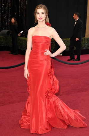 You can never go wrong with a red Valentino Couture gown. Red lipstick and lighter hair were the perfect combo for Anne in 2011.
