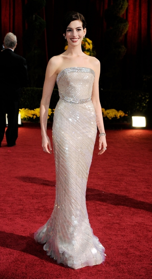 Nominated for Best Actress in 2009 for 'Rachel Getting Married', Anne looks like a mermaid in this Giorgio Armani Prive gown. The sequins are gorgeous.