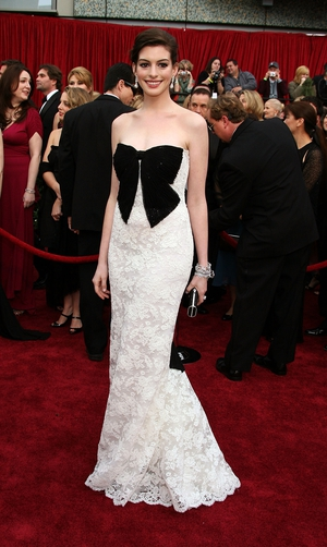 More Valentino! This white lace and statement bow (all the rage again now) dress is tricky to pull off but rocked it at the ceremony in 2007.