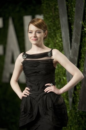 Really cute Emma in this elaborated Chanel Couture black dress at the Vanity Fair Oscar Party in 2012.